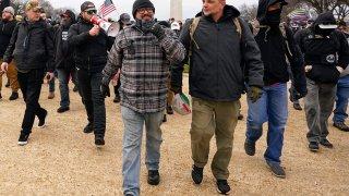 Proud Boys including Joseph Biggs, front left, walks toward the U.S. Capitol in Washington