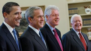 Former Presidents Barack Obama, George W. Bush, Bill Clinton and Jimmy Carter seen in the Oval Office at the White House in Washington, D.C., Jan. 7, 2009. The former Presidents of the United States have come together to promote vaccinations in two national ad campaigns.
