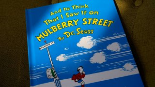 """A copy of the book """"And to Think That I Saw It on Mulberry Street,"""" by Dr. Seuss, March 1, 2021, in Walpole, Massachusetts. Dr. Seuss Enterprises, the business that preserves and protects the author and illustrator's legacy, announced on his birthday, March 2, 2021, that it would cease publication of several children's titles including """"And to Think That I Saw It on Mulberry Street"""" and """"If I Ran the Zoo,"""" because of insensitive and racist imagery."""