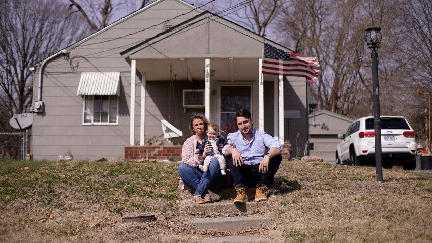 Logan DeWitt with his wife Mckenzie and daughter Elizabeth