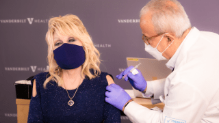 Dolly Parton receives her coronavirus vaccine in Nashville, Tennessee.