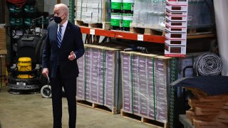 US President Joe Biden speaks while visiting Smith Flooring, a small minority-owned business, to promote his American Rescue Plan in Chester, Pennsylvania, on March 16, 2021.