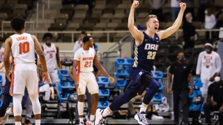 In this March 21, 2021, file photo, Francis Lacis #22 of the Oral Roberts Golden Eagles celebrates the Eagles victory over the Florida Gators in the second round of the 2021 NCAA Division I Mens Basketball Tournament held at Indiana Farmers Coliseum in Indianapolis, Indiana.