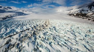 File photo of the Knik Glacier in Alaska. On March 27, 2021, five people were killed in a helicopter crash near the glacier.