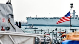 In this file photo, a US Navy patrol ship guards US and coalitions ships docked at the US 5th Fleet Command in Bahrain's capital Manama on December 17, 2019.