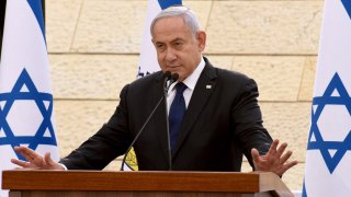Israeli Prime Minister Benjamin Netanyahu speaks during a ceremony to mark Yom HaZikaron, Israel's Memorial Day for fallen soldiers, at the Yad LeBanim House in Jerusalem on April 13, 2021.
