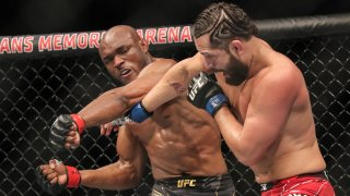 Kamaru Usman (L) of Nigeria fights Jorge Masvidal of the United States during the Welterweight Title bout of UFC 261 at VyStar Veterans Memorial Arena on April 25, 2021 in Jacksonville, Florida.