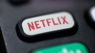 a logo for Netflix on a remote control