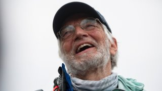 American climber Arthur Muir, 75, gestures as he arrives in Kathmandu, Nepal, Sunday, May 30, 2021. The retired attorney from Chicago who became the oldest American to scale Mount Everest, and a Hong Kong teacher who is now the fastest female climber of the world's highest peak, on Sunday returned safely from the mountain where climbing teams have been struggling with bad weather and a coronavirus outbreak. Arthur Muir, 75, scaled the peak earlier this month, beating the record by another American, Bill Burke, at age 67.