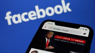 Donald Trump's Facebook account is seen displayed on a phone screen with Facebook logo in the background in this illustration photo taken in Krakow, Poland on May 6, 2021