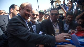 In this file photo, Iran's parliament speaker Mohammad Bagher Qalibaf (L) casts his ballot at a polling station during the first round of the presidential election on June 14, 2013 in Tehran, Iran.
