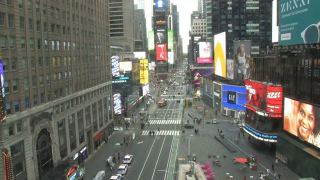 Police cordoned off roads around Times Square following the shooting of a woman and toddler, senior NYPD officials said Saturday.