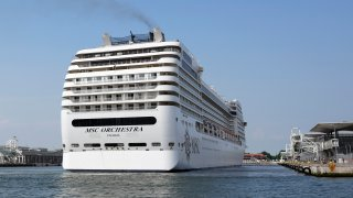 The the 92,409-ton, 16-deck MSC Orchestra cruise ship exits the lagoon as it leaves Venice, Italy