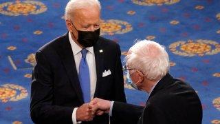 President Joe Biden greets Sen. Bernie Sanders
