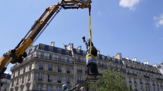 """Workers secure the move of the """"Liberty Enlightening the World"""" by Frederic Auguste Bartholdi, a mini-replica of the French-designed Statue of Liberty"""