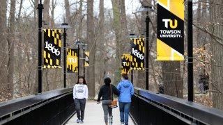 Towson University students walk on campus