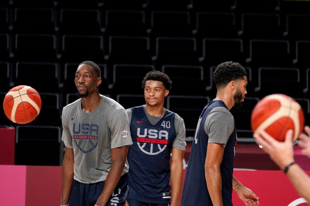United States' Bam Adebayo, from left, Keldon Johnson, and Jayson Tatum, walk on the court
