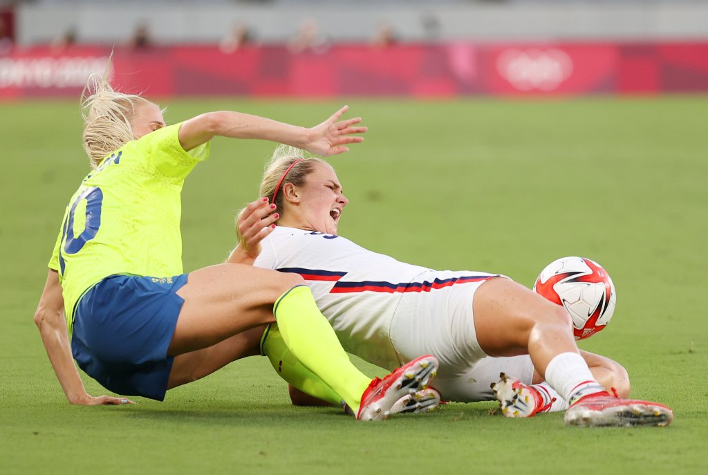 Lindsey Horan #9 of Team United States is challenged by Sofia Jakobsson #10 of Team Sweden during the Women's First Round Group G match between Sweden and United States during the Tokyo 2020 Olympic Games at Tokyo Stadium on July 21, 2021 in Chofu, Tokyo, Japan.
