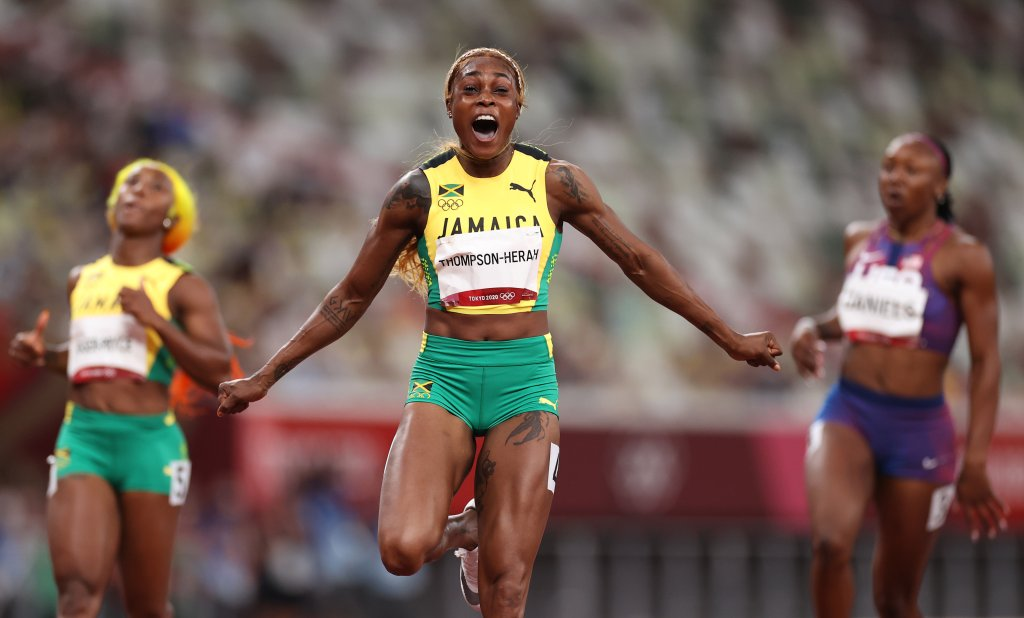 Elaine Thompson-Herah of Team Jamaica celebrates after winning the gold medal in the Women's 100m Final on day eight of the Tokyo 2020 Olympic Games at Olympic Stadium on July 31, 2021, in Tokyo, Japan.