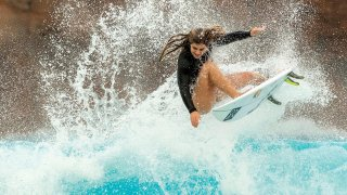 Caroline Marks surfing