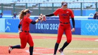 Monica Abbott (right) celebrates a strikeout with U.S. teammate Haylie McCleney.