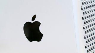 the Apple logo displayed on a Mac Pro desktop computer