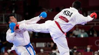 Sajad Ganjzadeh of Iran, left, is injured while competing against Tareg Hamedi