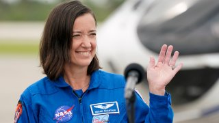 SpaceX Crew 2 member, NASA astronaut Megan McArthur waves as she arrives at the Kennedy Space Center in Cape Canaveral, Fla., Friday, April 16, 2021. The launch to the International Space Station is targeted for April 22.
