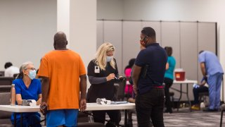 people register for a COVID-19 vaccination