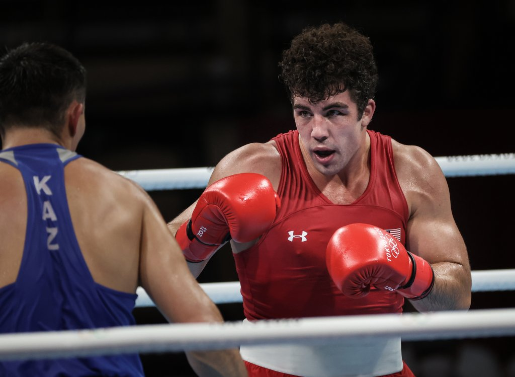 USA's Richard Torrez Jr (red) and Kazakhstan's Kamshybek Kunkabayev compete during their men's super heavy (over 91kg) semi-final boxing match during the Tokyo 2020 Olympic Games