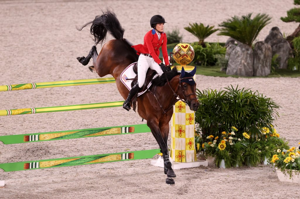 Jessica Springsteen and her horse jump over a barrier