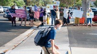 Anti-mask protestors in front of school