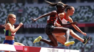 Hyvin Kiyeng of Team Kenya and Lili Anna Toth of Team Hungary compete in round one of the Women's 3000m Steeplechase heats on day nine of the Tokyo 2020 Olympic Games