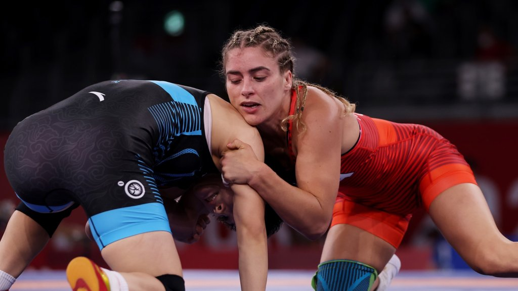 Helen Maroulis in red gets on top of China's Ningning Rong in a 1/8 final wrestling match at the Olympics