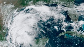This satellite image provided by NOAA shows Tropical Storm Nicholas in the Gulf of Mexico on Sunday, Sept. 12, 2021