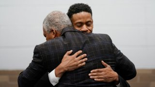 Aretha Franklin's sons Kecalf Franklin, rear, hugs Edward Franklin after a ceremony honoring Aretha Franklin, Monday, Oct. 4, 2021, in Detroit. Franklin was given a bit of R-E-S-P-E-C-T when a post office in her hometown of Detroit was named after the late singer. Members of Franklin's family as well as postal and elected officials visited the former Fox Creek post office to celebrate the name change honoring the Queen of Soul.