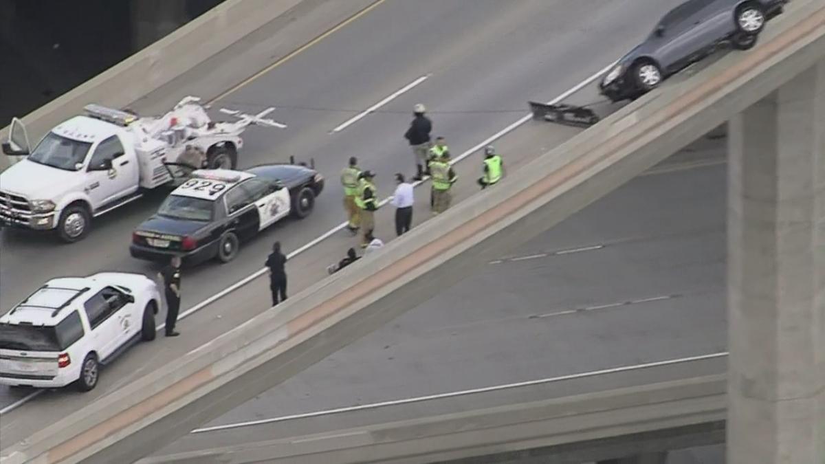 Car Teeters on Edge of Freeway Connector