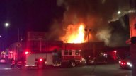 Flames Shoot Out of the Warehouse
