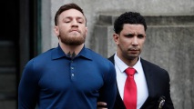AP_18096527799299 Raw Video: MMA Fighter Conor McGregor Led Away After Arrest