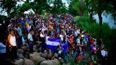 Migrant Caravan Swells to 5,000 Resumes Advance Toward US