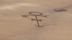 Farmer Plows Prince's Symbol in Field