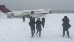 Plane Slides Off Runway at LaGuardia