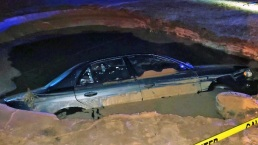 Suspected Drunken Driver Nearly Drowns in Sinkhole After Crash