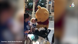 Winnie The Pooh Comforts Disabled Child at Disney World