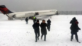 Plane Skids Off Runway at NYC's LaGuardia Airport