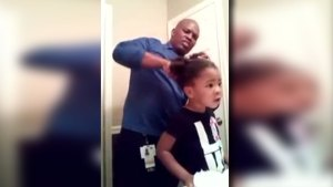 Girl Gives Dad Tips While He Does Her Hair in Viral Video