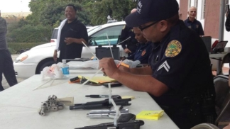 Police Trade Gift Cards for Guns in Miami Buyback Event