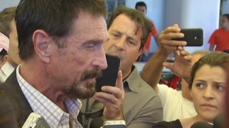 John McAfee Speaks With Reporters Outside Beacon Hotel in Miami Beach