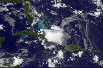 System Continues to Produce Heavy Rains, Thunderstorms