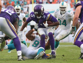 Late Safety Helps Dolphins Rally Past Vikings 37-35